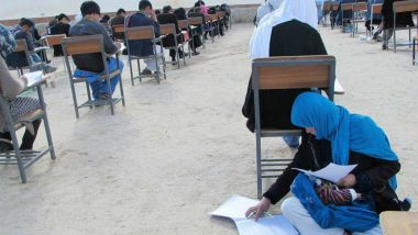 Afghan Woman's Incredible Photo Nursing Her Baby While Appearing For University Entrance Exam Goes Viral