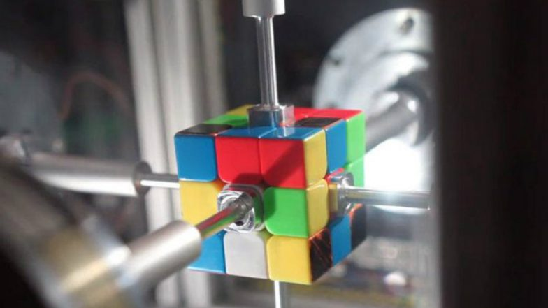 Man Vs Robot Who Can Solve Rubik's Cube Faster? Watch World-record Breaking Video