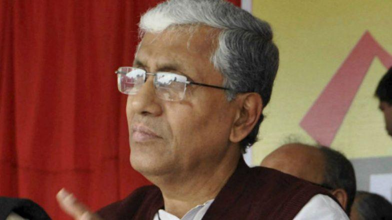 Tripura Chief Minister Biplab Deb touches Manik Sarkar's feet