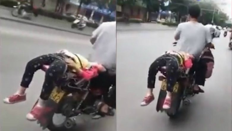 Chinese Father Forcefully Takes Reluctant Daughter to School by Tying Her on Bike, Video Goes Viral