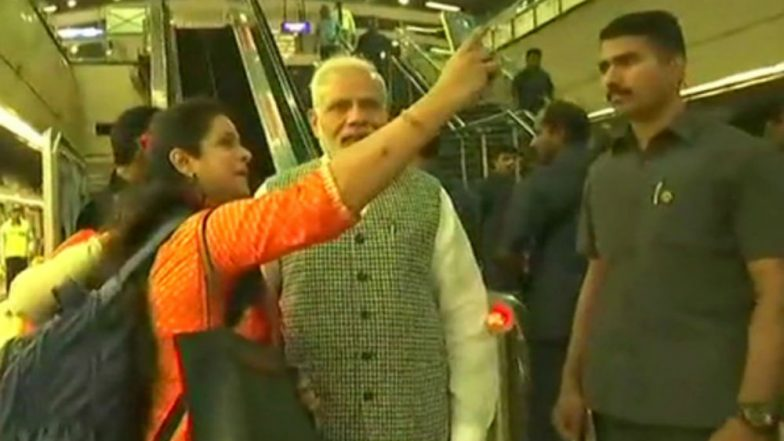 PM Modi rides to North Delhi by Metro, clicks selfies with passengers