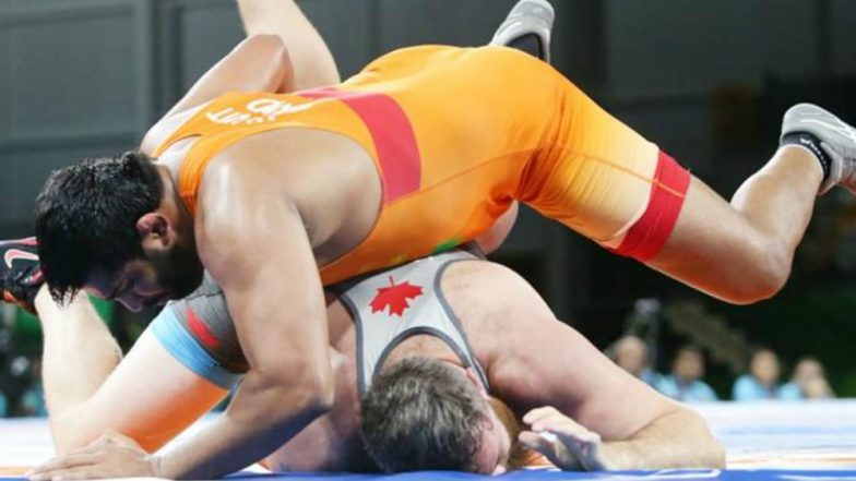 Vinesh Phogat and Sumit clinch CWG gold medals in wrestling