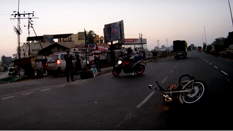Royal Enfield Bullet Motorcycle Crashes at High Speed on Indian road - Watch Video