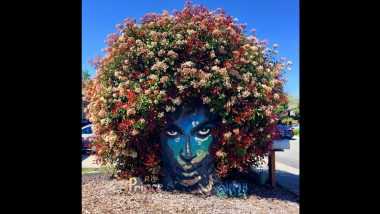 Prince Mural Blooms With Colorful Flowers in Shape of Late Singer's Hair