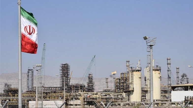 Oil firm as Saudi output dips, Iran sanctions loom