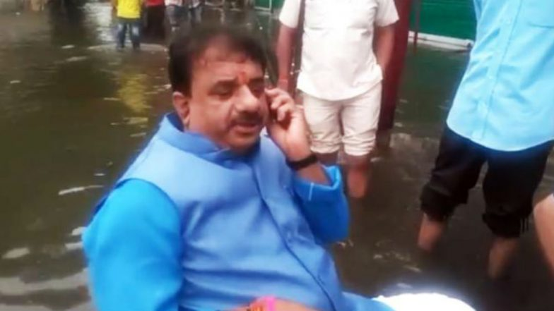 Watch Video: Bhopal Mayor Protests Against Floods, Sits in Middle of Water-Logged Street to Take Stock of Situation