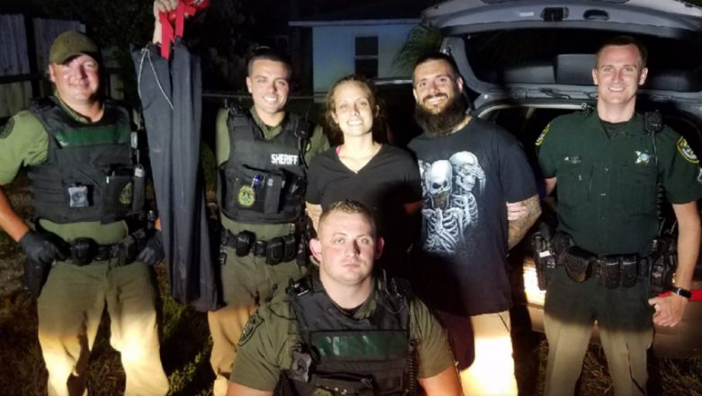 Florida Couple Pose & Smile With Police Officers After Their Arrest, Photos Go Viral