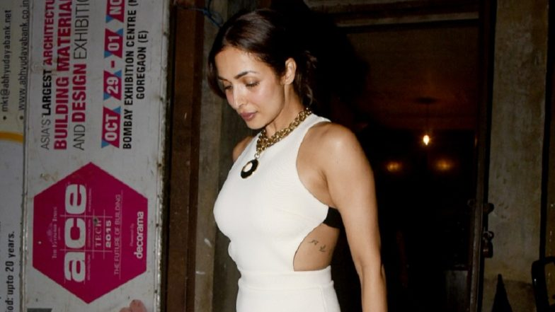 Malaika Arora's Little White Peek-A-Boo Dress Is What You Should Wear On Your Date-Night - View Pics