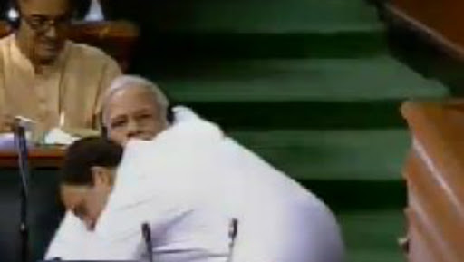 Rahul Gandhi Hugs Narendra Modi After Finishing His Speech on No Confidence Motion in Lok Sabha & then Winks: View Video & Pics