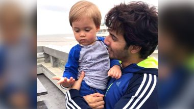 Varun Dhawan Enjoys the Rainy Weather with Yash Johar in This Absolutely Adorable Pic!