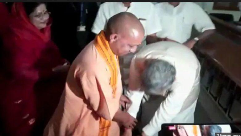 Chhattisgarh CM Raman Singh Touches Yogi Adityanath's Feet Before Filing Election Nomination: Watch Video