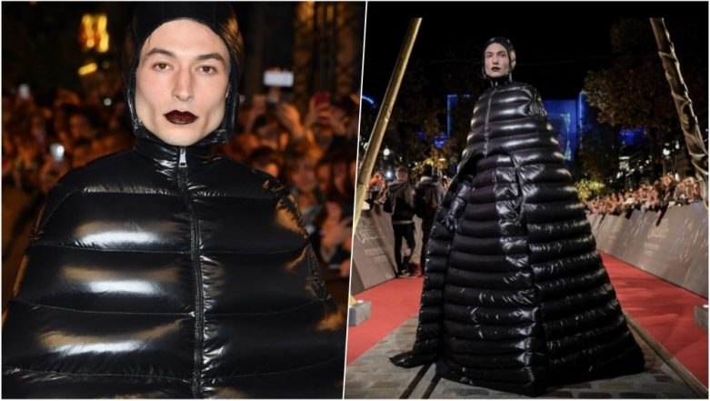 Ezra Miller Walks in a Shiny Puffer Coat at the Red-Carpet Event of Fantastic Beasts Premiere in Paris, See Pics