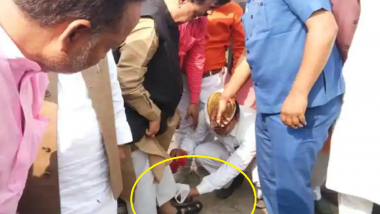 BJP Minister From UP Rajendra Pratap Singh Caught on Camera Getting His Sandals Cleaned by Staff Member in Kushinagar; Watch Video