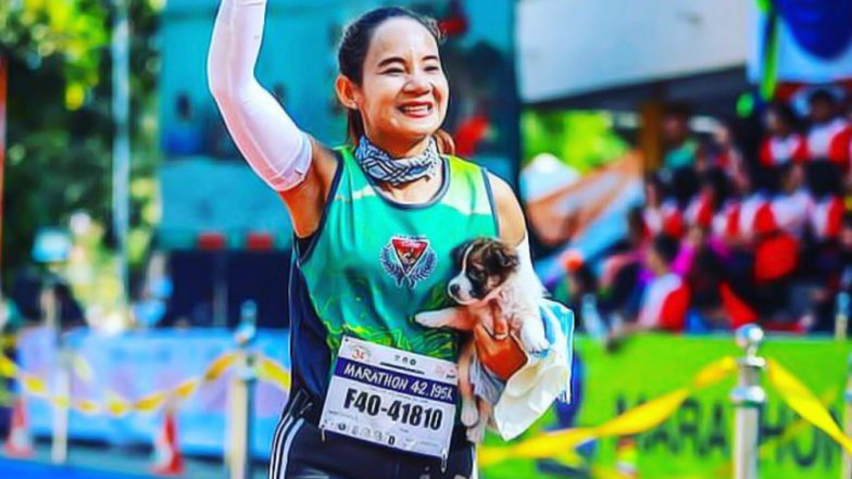 Marathoner Khemijra Klongsanun Finishes Race Holding an Abandoned Puppy She Found on Her Way in Thailand (See Pic)