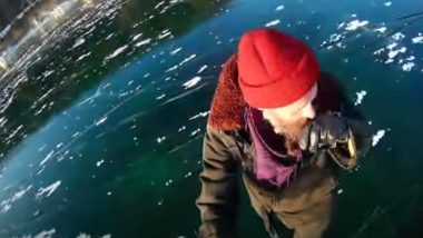 Man Walks on Frozen Baikal Lake in Russia, the Deepest freshwater Lake in the world- Watch Stunning Video From Siberia