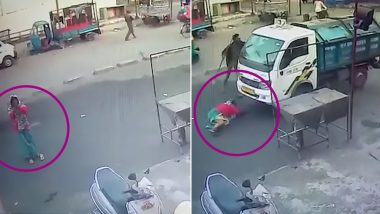 Vehicle Runs Over Woman Praying in Temple in Gujarat, Miraculously Survives The Accident (Watch Video)