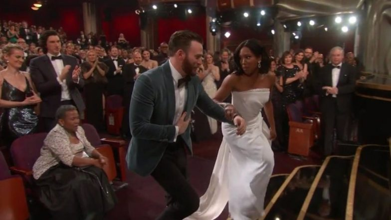Chris Evans Proves That Chivalry Isn't Dead By Helping Regina King With Her Gown At The Oscars 2019! [Watch Video]
