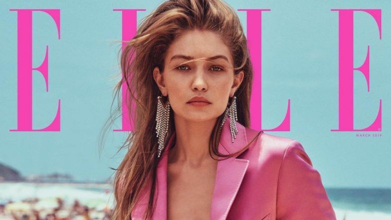 Gigi Hadid's Fuschia Pink Wetsuit With A Twist On The Cover Of Elle USA Is Putting Us In Hot Water (For Looking Too Hot To Handle!)