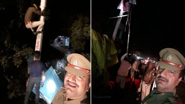 Unnao Shocker: UP Police Sub-Inspector Makes Constable Climb Electricity Pole to Remove Poll Posters While He Enjoys 'Selfies'