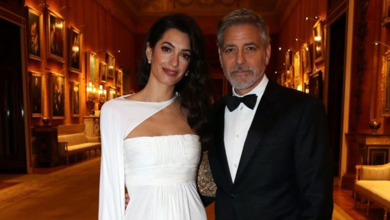 Amal Clooney Looks Angelic In A Floor-Length White Gown As She Accompanies George Clooney To The Buckingham Palace Party - View Pics