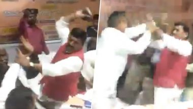 BJP MP Sharad Tripathi Beats Own Party MLA Rakesh Baghel With Shoes at Meeting in Uttar Pradesh, Watch Video