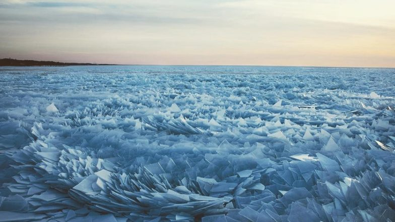 lake michigan looks stunning as frozen ice breaks into a. Black Bedroom Furniture Sets. Home Design Ideas