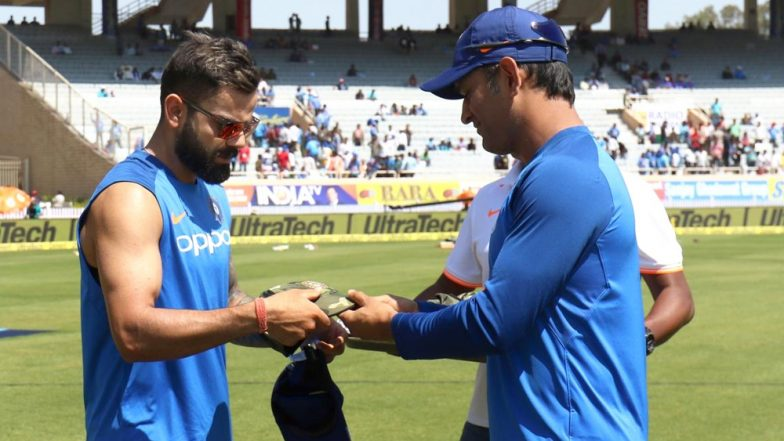 MS Dhoni Hands Specially Designed Army Caps  to the Players to Pay Tribute to Martyrs of Pulwama Attack Ahead of IND vs AUS 3rd ODI 2019 (Watch Video)