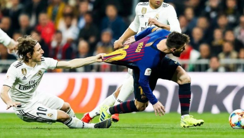 Barcelona Takes a Dig at Real Madrid's Luka Modric for Pulling Lionel Messi's Jersey
