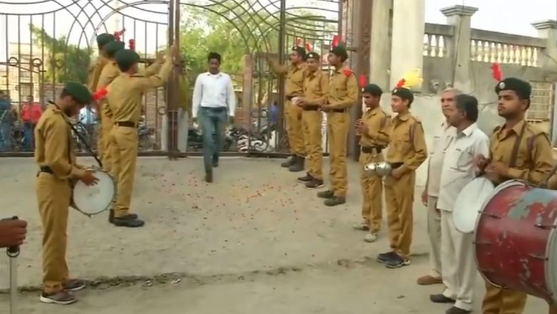 Uttar Pradesh Lok Sabha Elections 2019: Dhol And Flower Petals Welcome Voters at Polling Booth in Baghpat (Watch Video)