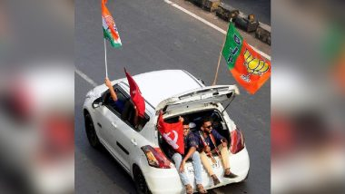 Viral Pic of Friends Travelling in Same Car Holding Flags of BJP, Congress and CPI(M) Is What India Needs Right Now!