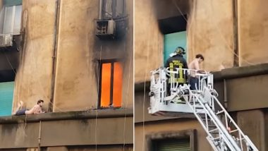 Man Clings to a Building on Fire, Firefighters Rescue Him on a Crane (Watch Dangerous Video)