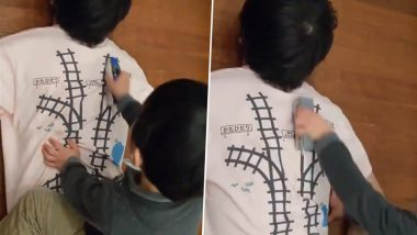 Genius Dad! Japanese Man Designs T-shirt With Railway Tracks on Back So That He Gets a Massage Whenever His Child Plays (Watch Viral Video)