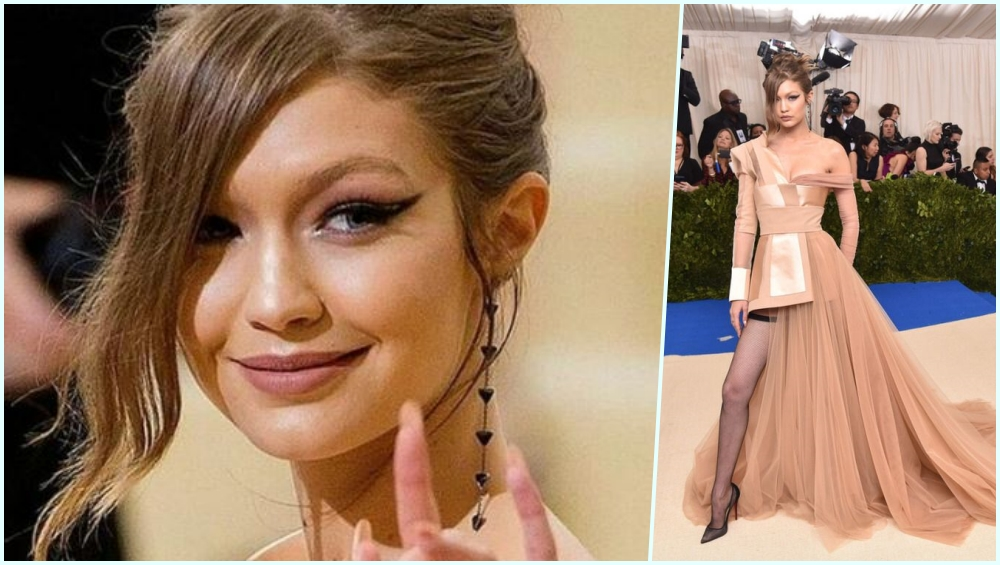 84d9ee90e Gigi made a solo entrance at the Met Gala 2017 and her dress went a notch  edgier for 2016's. She wore a Tommy Hilfiger nude dress to the Met Ball  with a ...