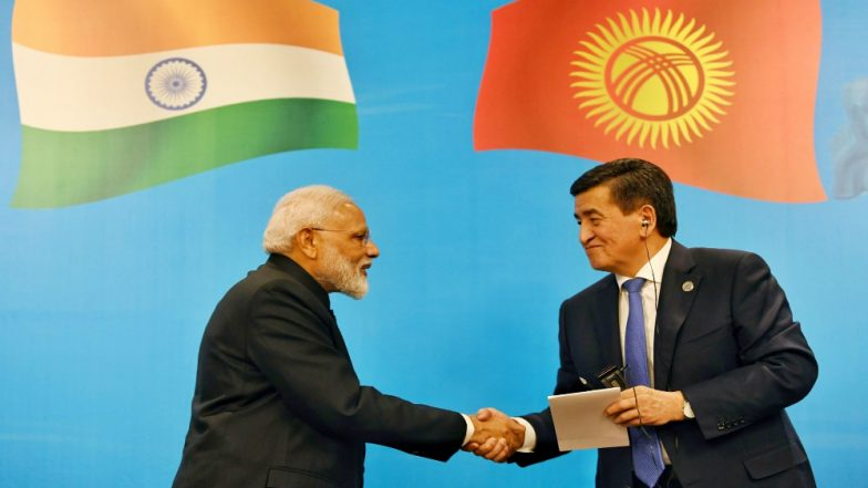 Kyrgyz President Sooronbay Jeenbekov Gifts Hat and Coat of His Country to Narendra Modi