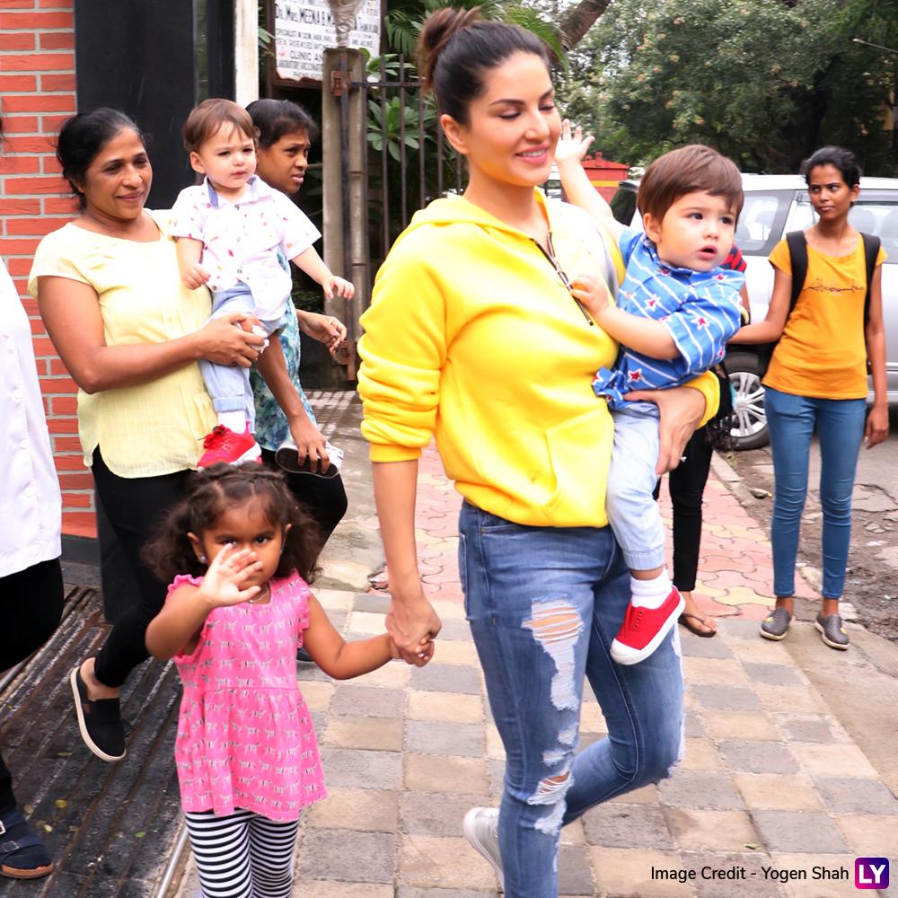 Sunny Leone's daughter Nisha Kaur Weber waves at the paparazzi.