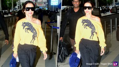 Yo Or Hell No! Malaika Arora In Yellow Wrangler T-Shirt at Mumbai Airport