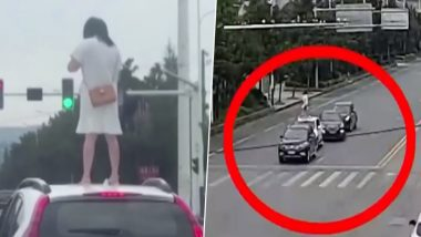Angry Wife Climbs on Top of Car Roof at Signal in China After Fight With Husband, Watch Viral Video