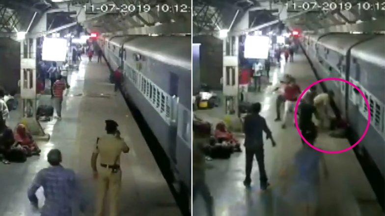 Woman Falls Off Platform While Boarding Moving Train at Ahmedabad Railway Station, RPF Jawan And Bystanders Save Her - Watch Video
