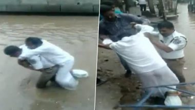 Hyderabad Traffic Cop Wades Through Waterlogged Road Carrying Man With Plastered Leg on His Back, Watch Video