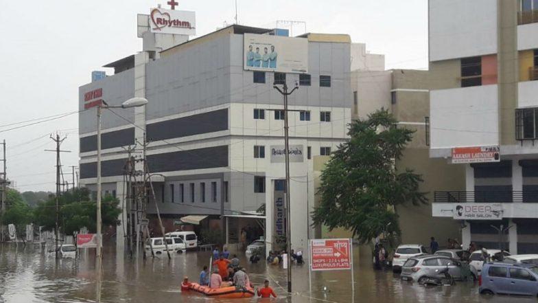 Gujarat Rains: IAF Officer Flight Lieutenant Karan Deshmukh Saves Old Lady From Floods in Navasari, Watch Video of Rescue