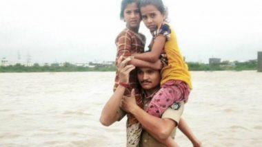 Gujarat Flood: Police Rescues 2 Kids on Shoulder, Video Goes Viral