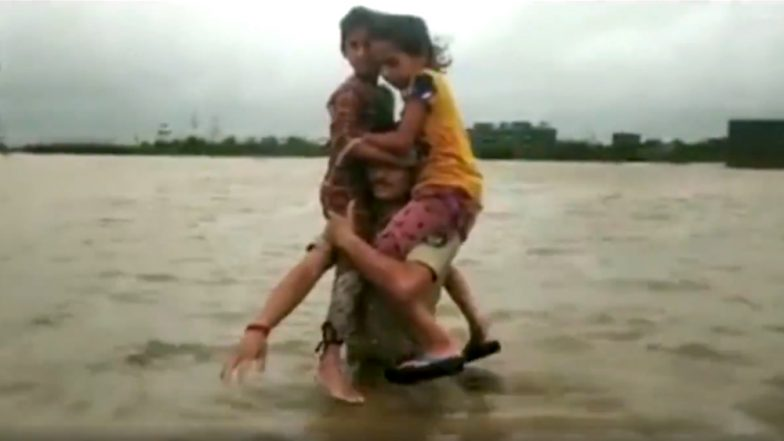 Gujarat Rains: Brave Constable Carries Two Children on His Shoulders in Flood-Affected Morbi District; Watch Video