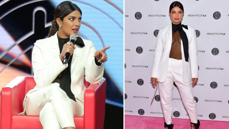Priyanka Chopra Looks Super Hot in her White Pantsuit with a See Through Black Blouse at BeautyCon LA (View Pics)