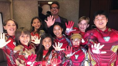Robert Downey Jr Wins The Best Action Movie Actor At The Teen Choice Awards And A Formidable Iron-Man Suit Clad Teens Hand Him The Trophy!