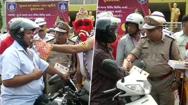Gujarat: Rajkot Cops Dress As Lord Ganpati, Offer Laddus to Those Riding Bike Wearing Helmet; See Pics