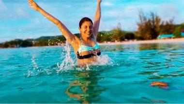 Anushka Sharma Turns Into a Happy Water Baby as She Slays In a Bikini on a Beach Vacation (View Pics)