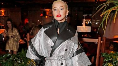 Christina Aguilera Looks Like a Disco Ball in Shiny Trench Coat at the London Fashion Week
