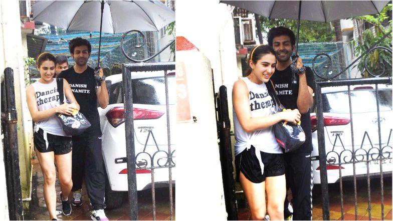 Netizens Call Kartik Aaryan the 'Perfect Boyfriend' for Holding an Umbrella for Sara Ali Khan Amidst Rains - View Pics