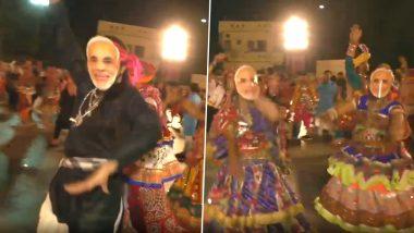 Navratri 2019: People Wear PM Narendra Modi Masks While Performing 'Garba' in Surat (Watch Video)