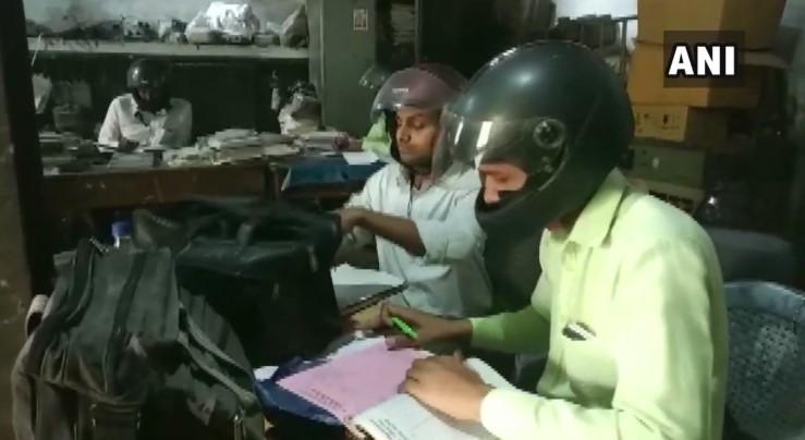 Shocking! Employees of Uttar Pradesh Government Office Wear Helmets While Doing Desk Job, Here's Why